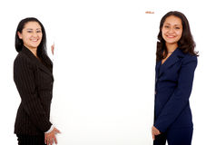 Business women holding a billboard Stock Images