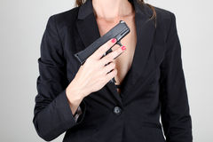 Business women holding black gun Stock Photography