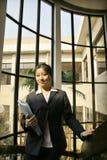 Business women holding folder. Asian business women holding folder on stair Stock Images