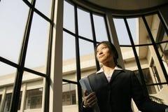Business women holding folder. Asian business women holding folder on stair Stock Photo
