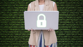 Business women holding laptop with cyber security firewall Royalty Free Stock Photo