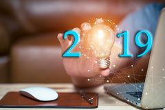 Business 2019 holding light bulbs, ideas of new ideas with inno royalty free stock photography
