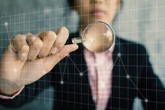 Business women holding magnifying glass royalty free stock photo