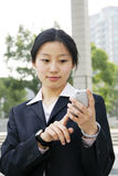 Business women holding a mobile phone Royalty Free Stock Image