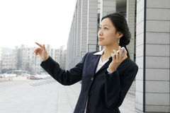 Business women holding a mobile phone. Asian business women holding a mobile phone Stock Photos