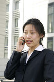 Business women holding a mobile phone Royalty Free Stock Photography