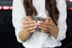 Business women holding money jar royalty free stock images