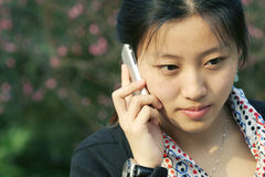 Business women holding  phone. Asian business women holding a mobile phone in park Stock Photography