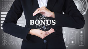Business women holding posts in bonus. Can be used in advertising royalty free stock image