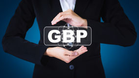 Business women holding posts in GBP. Can be used in advertising stock image