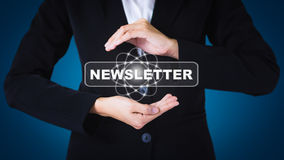 Business women holding posts in NEWSLETTER. Can be used in advertising Royalty Free Stock Image