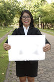 Business women holding signs Royalty Free Stock Image