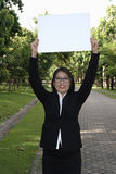 Business women holding signs Stock Photos