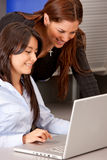 Business women on a laptop Stock Images