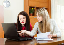 Business  women with laptop at table Royalty Free Stock Photo