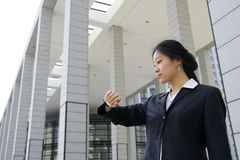 Business women look at her watch. Young asian business women look at her watch Royalty Free Stock Images