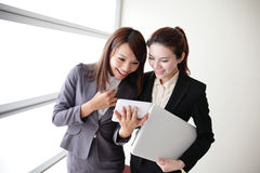 Business women look and smile conversation Royalty Free Stock Photo