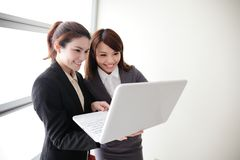 Business women look and smile conversation Royalty Free Stock Photography
