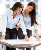 Business women looking at blueprints Stock Photos