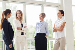 Business women meeting at office and talking. People, work and corporate concept - business women meeting at office and talking stock image