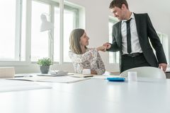Business woman and man bumping their fists together stock images
