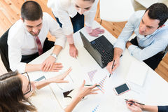 Business women and men in meeting Royalty Free Stock Image