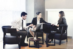 Two business women and a business man working Royalty Free Stock Photo