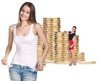 Business women near stack of golden coins. Isolated on the white background royalty free stock images