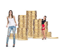 Business women near stack of golden coins. Isolated on the white background stock photo