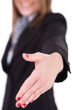 Business women offering a hand shake Royalty Free Stock Image