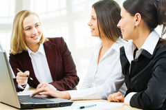 Business women at office Stock Images