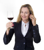 Business women with phone and wine Royalty Free Stock Photo