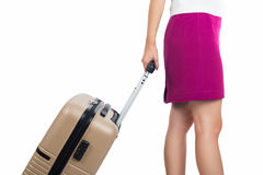Business women pink skirt holding suitcase isolated white backgr Stock Photos