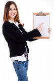 Business women pointing on a blank clip board Royalty Free Stock Image