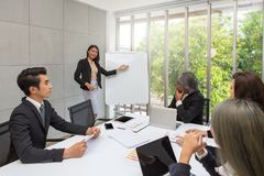 Business women are present in the meeting room. Group business working at the office. Team workers are talking business plan. royalty free stock photography