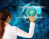 Business women pushing a button on a touch screen. Interface Stock Photography