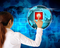 Business women pushing a button. On a touch screen interface Stock Photos