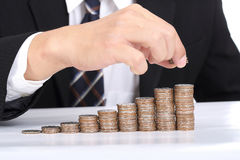 Business women put coin stack money Stock Photography