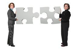Business women - puzzle pieces Stock Photos