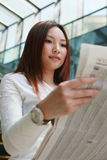 Business women reading newspaper Stock Image