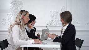 Business women receiving money in the office. Professional shot on BMCC RAW with high dynamic range. You can use it e.g in your commercial video, business stock video