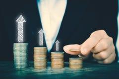 Business women saving for money. With financial arrow Stock Photos