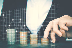 Business women saving for money. With financial graph Royalty Free Stock Photos