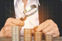 Business women saving for money. With financial graph Royalty Free Stock Images