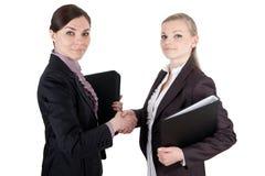 Business women shake hands Stock Image