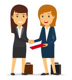 Business women shaking hands Stock Photos