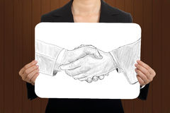 Business women show  shaking hands sketch concept Stock Images