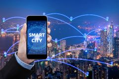 Business women show Smart city connection with smartphone over smart city communication network. And internet of things for network communication concept royalty free stock photo