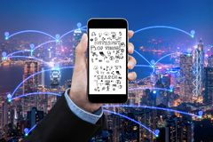 Business women show Smart city connection with smartphone over smart city communication network. And internet of things for network communication concept stock photos