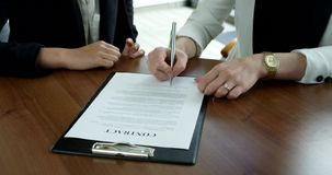 Business women Signing Contract. At meeting close up view stock video footage